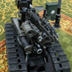 With a weapons platform mounted to a Talon robot, the SWORDS system allows Soldiers to fire small arms weapons by remote control from as far as 1,000 meters away. The system, demonstrated this week at the bienniel Army Science Conference, may soon join Soldiers in Iraq.
