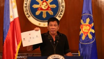 Rodrigo_Duterte_showing_diagram_of_drug_trade_network_1_7.7.16